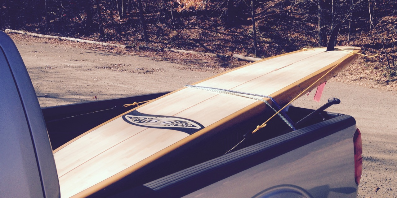 paddle board strapped in truck