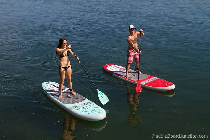 Two People Riding inflatable Paddle Boards