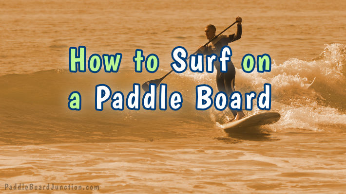 how to surf on a paddle board