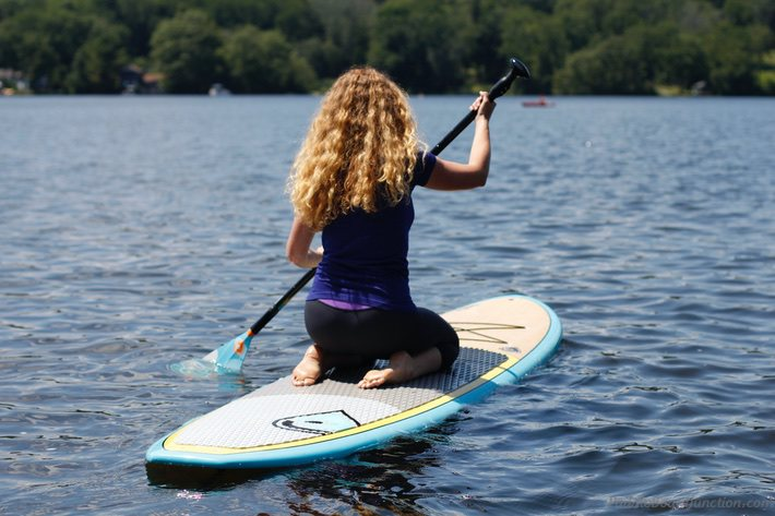 kneeling and paddling your paddle board
